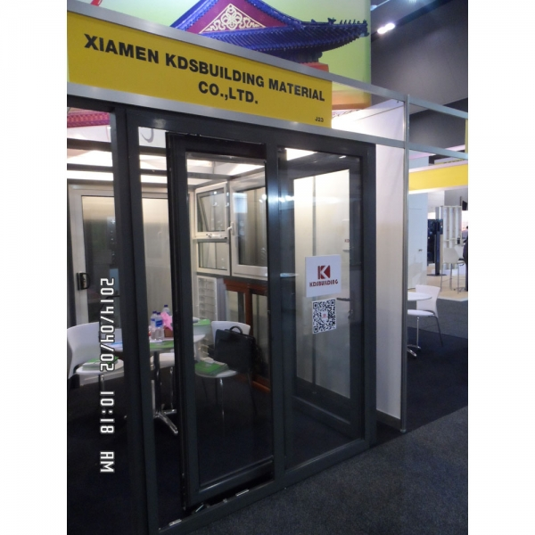 buy Aluminum glass tilt sliding doors with grey aluminum profile and clear glazing